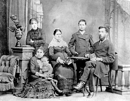 Emma Goldman's family in St. Petersburg, Russia in 1882. From left to right: Emma, standing; Helena, seated, with Morris on her lap; Taube; Herman; Abraham. Emma Goldman's family.jpg