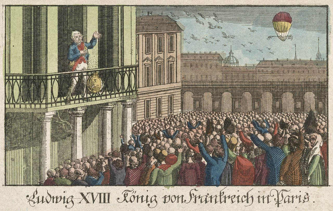 King Louis XVIII standing on a balcony and a crowd below watching a hot air balloon in the distance.