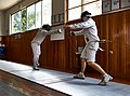 Extension and touch for the fencer on the left against the fencer on the right.jpg