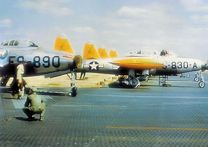 Quartier Général d'Aboville - Republic F-84G-1-RE Thunderjets 51-890 of the 494th Fighter Bomber Squadron and 51-830 of the 493d FBS. Note the Pierced Steel Planking being used for the parking apron as concrete pads have not yet been poured. Both aircraft were eventually sold to the Belgian Air Force as Serials FZ-175 and FZ-199. 890 was destroyed on 25 May 1955 at Sylt, West Germany.