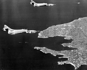 RAF Hal Far - U.S. Navy Grumman F9F-8P Cougars from VFP-62, flying from USS Saratoga (CVA-60), over RAF Hal Far in 1958.