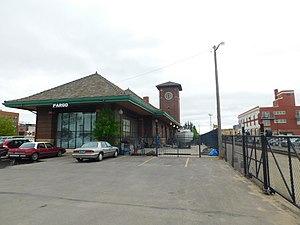 Fargo station - Fargo station in May 2017. The former Great Northern depot is on the left while the closed off platform is on the right.