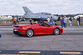 Ferrari F430 2006 Spider drives past Mikoyan-Gurevich MiG-21U Mongol-A TICO 13March2010 (14599445235).jpg