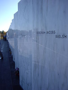 a marble wall with names inscribed on it.