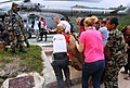 French and Polish Rescue team with Nepalese Army are boarding quake affected injured persons on an IAF Helicopters, in Melanchi, Nepal (2).jpg
