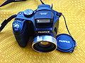 Fujifilm FinePix S5700 Digital camera black - front view.JPG
