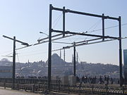 Detail of the break in the overhead lines for the trams between one bascule (left) and the fixed part of the bridge. The Süleymaniye Mosque is in the background.