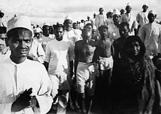 Direct action - Mahatma Gandhi and supporters Salt March on March 12, 1930. This was an act of nonviolent direct action.