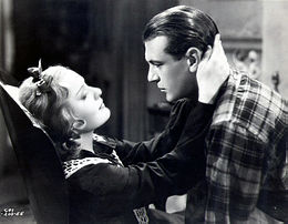 Photo of Gary Cooper and Anna Sten embracing each other