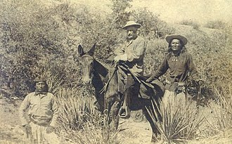 Apache Scouts - General Crook with White Mountain Apache Scout William Alchesay on the right, and an unknown Apache scout on the left.