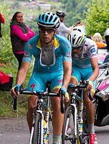 Mikel Landa, wearing the blue Astana jersey, riding ahead of Fabio Aru, who is wearing the white jersey of the best young rider