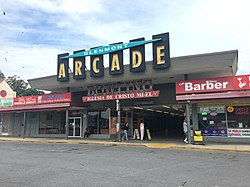 "A photograph of the entrance to ""Glenmont Arcade,"" located in the Glenmont Shopping Center, on October 2, 2018."