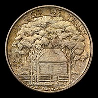 Silver dollar with a house shaded by trees