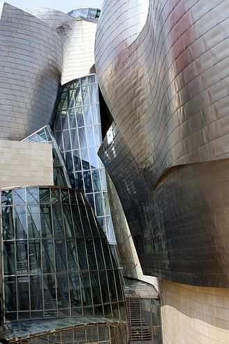 Guggenheim Museum Bilbao - The museum is clad in glass, titanium, and limestone