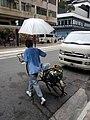 HK 西環 Sai Ying Pun 德輔道西 Des Voeux Road West visitor umbrella bicycle Toyota motor van tram station stop 水街 電車站 Water Street August 2017 Lnv2.jpg