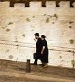 Haredi couple walking at night around the Tower of David.jpg