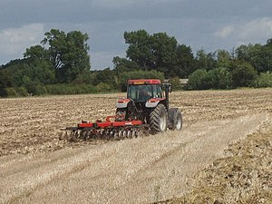 English: Harrowing to incorporate straw near T...