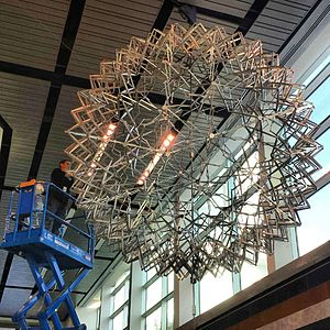 Chuck Hoberman - Second largest Hoberman sphere in the world, undergoing maintenance at Liberty Science Center