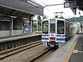 Hokuetsu Express HK100 at Matsudai Station.jpg