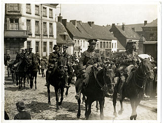V Battery Royal Horse Artillery - V Battery, Royal Horse Artillery, riding through Fenges, France.