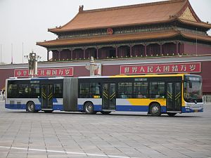 Beijing Bus - Beijing Bus 1 on Chang'an Avenue at Tiananmen Square.  The vehicle is produced by Huanghai Bus.
