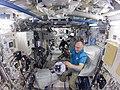 ISS-56 Ricky Arnold and Oleg Artemyev work in the Kibo lab.jpg