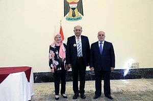 Thamir Ghadhban - Japanese Imperial Decorations ceremony. Mrs Ghadhban (left), Mr. Thamir Ghadhban (middle) and Prime Minister Haider al-Abadi (right). May 2016.