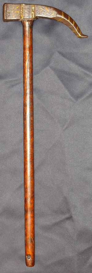 War hammer - Indo-Persian war hammer, heavy iron head with a hammer in front, a 4.5 in curved spike on the other side, cut channel decorations, hard wood shaft.