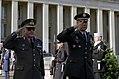Ioannis Veryvakis and Colin Powell saluting, 1993.jpg