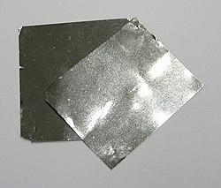 Two square pieces of gray foil