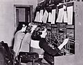 JBER telephone operators connect calls, people 120124-A-ZY202-001.jpg