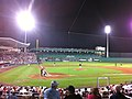 The Red Sox play a spring training game against the Yankees at night
