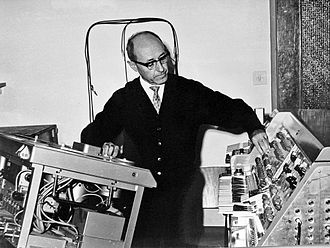 Studer - Israeli composer Josef Tal at the Electronic Music Studio in Jerusalem (c. 1965). On the right a sound synthesizer, on the left a Studer C37 vacuum tube reel-to-reel tape recorder
