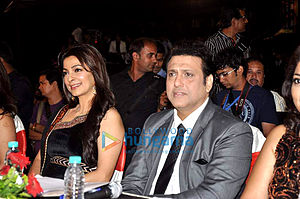 Govinda and Juhi Chawla, seated at a table
