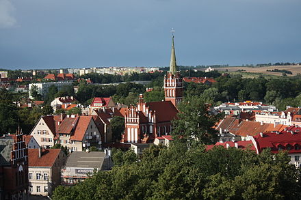 "The town of Ketrzyn was named after Wojciech Ketrzynski in 1946 as part of the region's Polonisation. Its previous Polish name was ""Rastembork"" Ketrzyn Widok ogolny miasta z kosciolem Sw. Katarzyny.JPG"