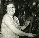 Kathleen Reynolds, first woman machine adjuster in the giant Winchester Ordnance plant, has 58 years of machine experience that is helping America's war effort (WWII) at Winchester Repeating Arms, New Haven, Conn. (cropped).jpg