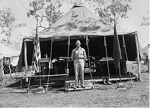A man standing in front of a large tent.