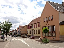 The town hall and main street in Kirrwiller