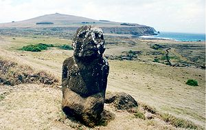 Rano Raraku - Tukuturi, with Poike in the background and Ahu Tongariki against the spray on the right