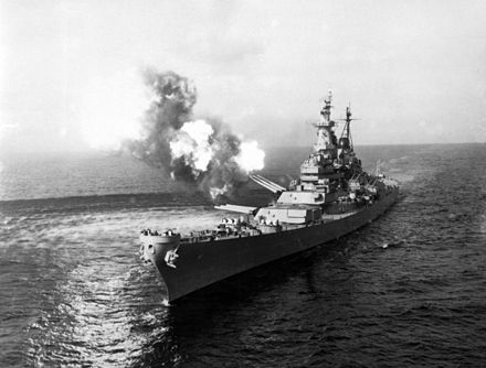 To disrupt North Korean communications, USS Missouri fires a salvo from its 16-inch guns at shore targets near Chongjin, North Korea, 21 October 1950 KoreanWarNavyGunfire.jpg
