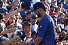 Kris Bryant signing autographs during his rehab assignment against Omaha (42507297210).jpg