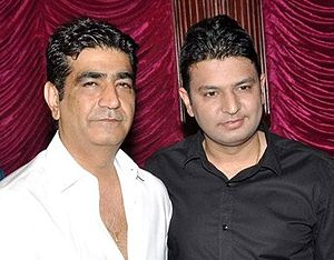 T-Series - Krishan Kumar (Younger brother of Gulshan Kumar) with his nephew Bhushan Kumar (Right) during the audio release of Aashiqui 2 (2013).