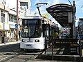 Kumamoto city tram stops at Wakaba-1-chome, Kumamoto, Japan; December 2010.jpg