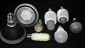 LED lamp - An assortment of LED lamps commercially available as of 2010 as replacements for screw-in bulbs, including floodlight fixtures (left), reading light (center), household lamps (center right and bottom), and low-power accent light (right) applications.