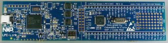 NXP LPC - LPC1343 LPCXpresso development board. LPC-LINK SWD debugger on left of J4 and target LPC1343 on right of J4