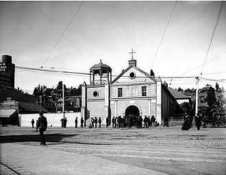 "Pueblo de Los Ángeles - People gather in the original Plaza in front of the   ""Old Plaza Church"", circa 1890-1900."