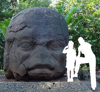 Olmec colossal heads - Monument 4 from La Venta with comparative size of an adult and child. The monument weighs almost 20 tons.
