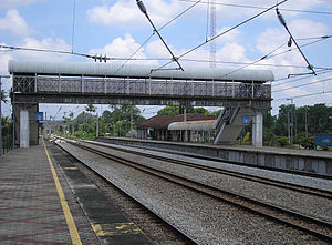 Labu Komuter station - A platform view of the Labu station, as seen northbound.