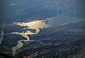 Lake Berryessa - Aerial view of Lake Berryessa, looking west into the evening sun