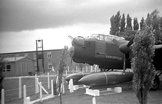 Avro Lancaster - Tallboy bombs displayed with a standard R5868 Lancaster at RAF Scampton.